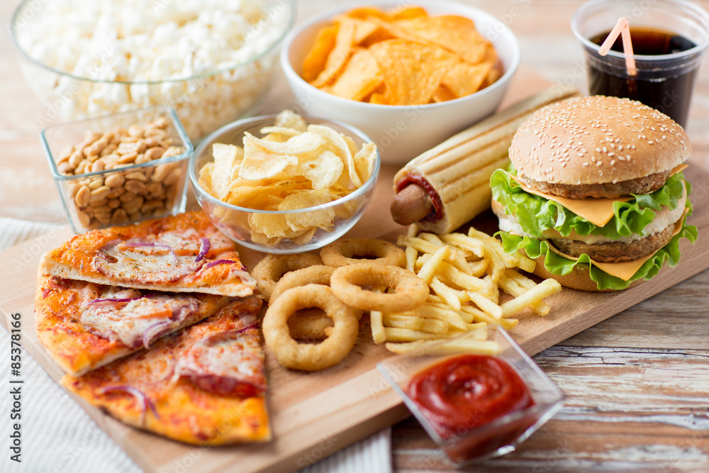 Fototapety, obrazy: close up of fast food snacks and drink on table