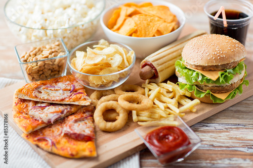 Spoed Foto op Canvas Eten close up of fast food snacks and drink on table