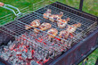 The process of cooking barbecue chicken on the grill (mangal)