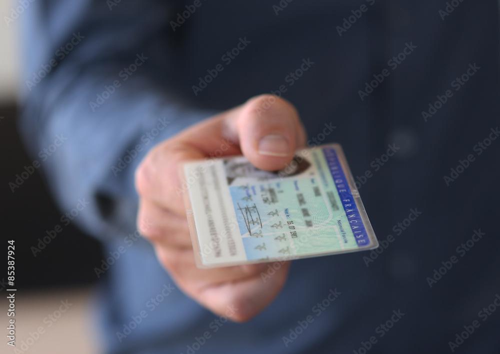 Fototapeta it gives a young man ID - carte d'identité nationale