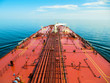 canvas print picture - Oil tanker is proceeding in blue ocean under cloudy sky - stock photo