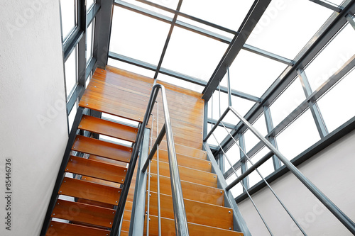 Photo Stands Stairs Downward View of a Wooden U-Shaped Modern Staircase