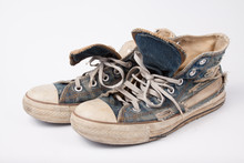 Old & Torn Shoes Isolated On W...