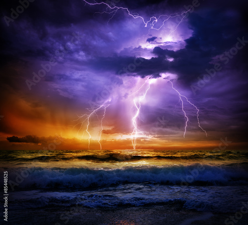 Photo sur Toile Tempete lightning and storm on sea to the sunset - bad weather