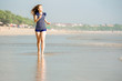 Healthy woman running on the beach, girl doing sport outdoor