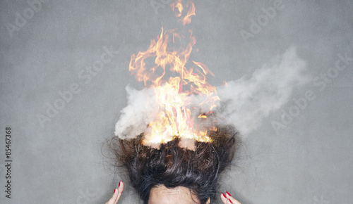 Fotografiet  brunette woman head hair on fire in flames
