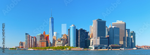 Deurstickers New York New York City lower Manhattan financial wall street district buildings skyline on a beautiful summer day with blue sky