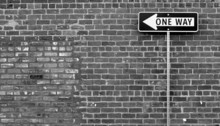 One Way Street Sign In Black A...