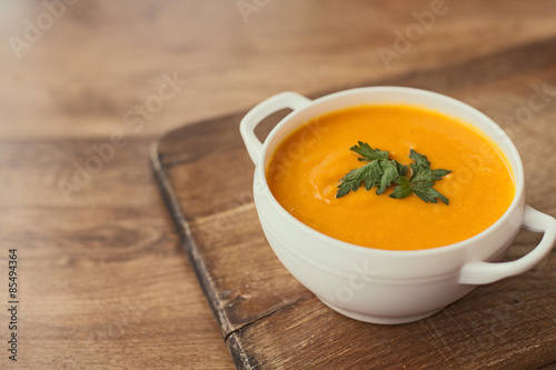 Fotografie, Obraz  carrot cream soup on the wood table