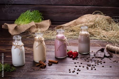 Foto op Aluminium Milkshake Various natural milkshakes on the wooden background.