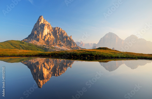 Fotobehang Bergen Mountain lake reflection, Dolomites, Passo Giau