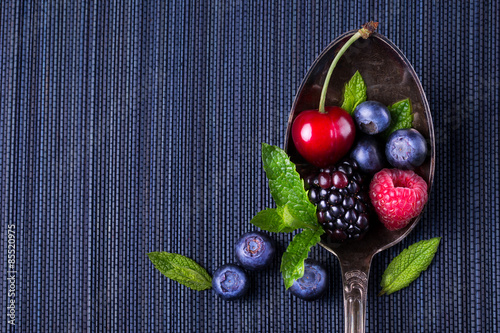 Food background - Berries on a spoon Wallpaper Mural
