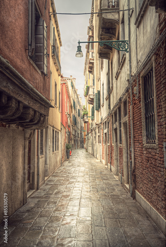 Poster Smal steegje typical narrow alley in street of Venice (Venezia) at a rainy day, vintage style, Italy, Europe
