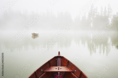 Obraz na płótnie Boats in mysterious fog