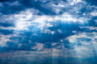 sky background with dark clouds and sun rays