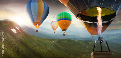 Colorful balloons flying in the mountain