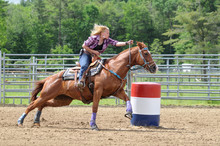 Young Adult Woman Galloping Around A Turn In A Barrel Race