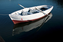 White Red Boat With Water Reflection