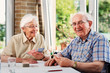 canvas print picture - Elderly couple playing cards