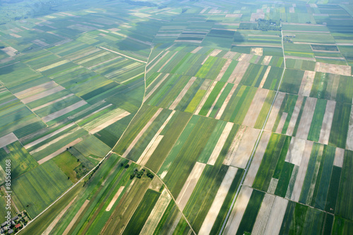 Wall Murals Air photo Aerial view of the countryside with village and fields of crops