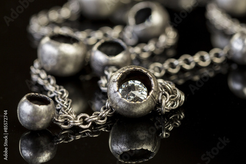 Fotografie, Obraz  Assorted silver costume jewellery with a jumbled pile of chains with different s