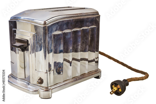 Old bread toaster isolated on white