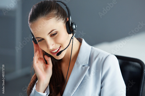 Call Center Operator Sitting Infront of Her Computer