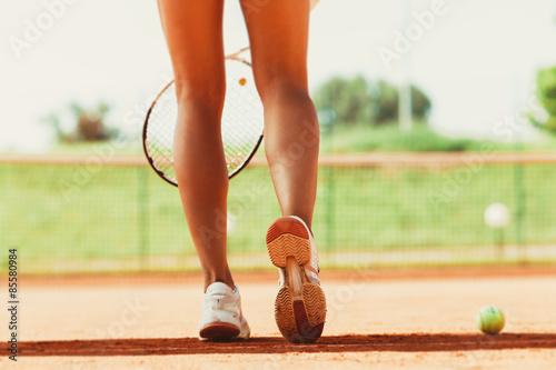 Plakát  Legs of female tennis player.Close up image.