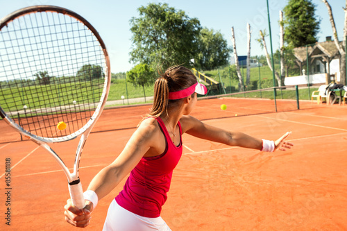Young woman playing tennis.High angle view.Forehand. Poster