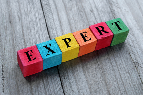 word expert on colorful wooden cubes