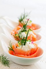 Fototapeta Appetizer of salted salmon and ricotta.