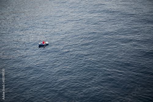 Lonely Rowboat on a Large Expanse of Sea Canvas Print