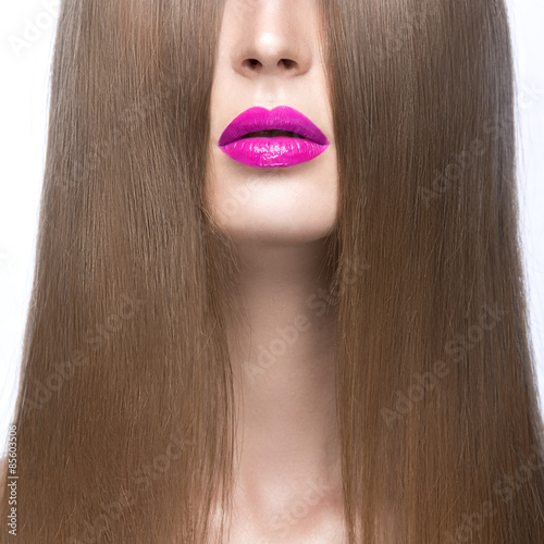 Foto op Aluminium Kapsalon Beautiful girl with a perfectly smooth hair and red lips. Beauty face. Picture taken in the studio on a white background.