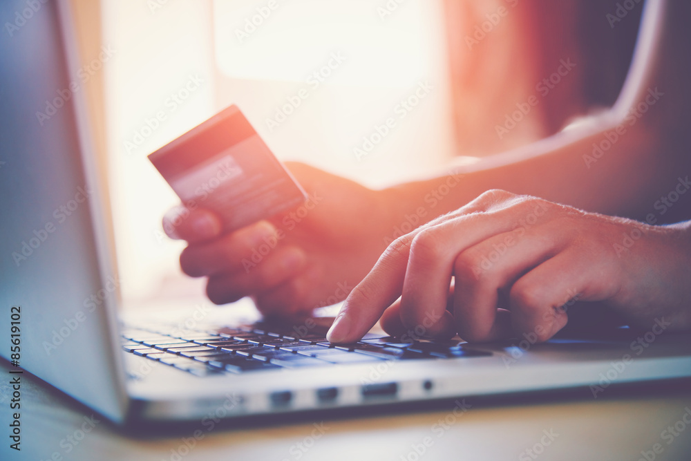Fototapety, obrazy: Hands holding credit card and using laptop. Online shopping