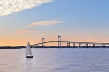 Newport Bridge Twilight Sunset With Sailboats Rhode Island USA A Popular New England Holiday Vacation Destination.