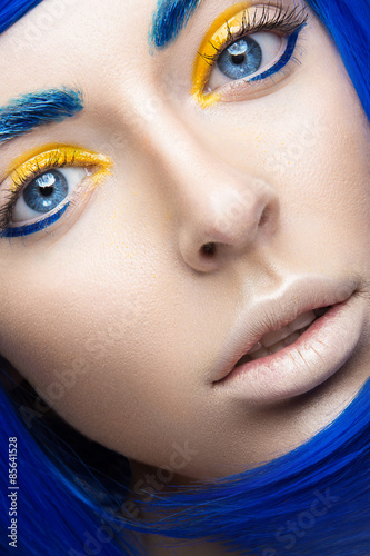 Fototapeta Beautiful girl in a bright blue wig in the style of cosplay and creative makeup