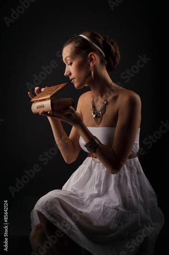 A girl acting Pandora as she opens the box Poster