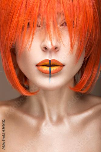Fototapeta Beautiful girl in an orange wig cosplay style with bright creative lips