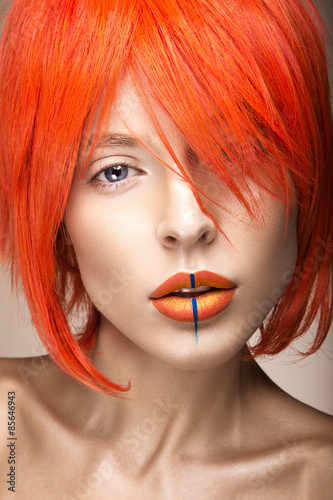 Obraz na plátně Beautiful girl in an orange wig cosplay style with bright creative lips