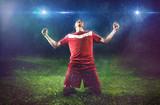 Fototapeta Sport - Victorious Soccer Player