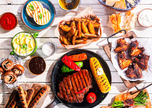Aluminium Prints Grill / Barbecue Barbequed Meats and Vegetables on Picnic Table