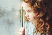 Portrait Of A Sad Child Lookin...