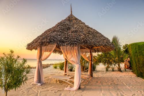 Poster Zanzibar Beach lounge chairs at sunset, Zanzibar, Tanzania