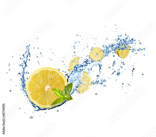 Pieces of lemons in water splash on white