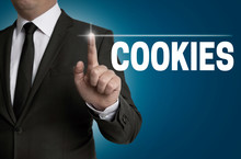 Cookies Touchscreen Is Operated By Businessman