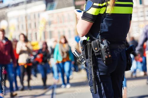 Fototapeta city safety. policeman in the street