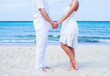Loving couple walking and embracing on a tropical summer beach