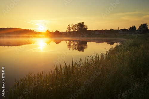 Deurstickers Zwavel geel Magical sunset over the lake in the village. Composition of Natu