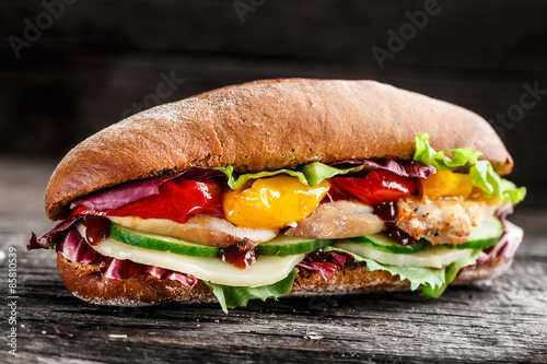 Staande foto Snack Sandwich with chicken, cheese and vegetables