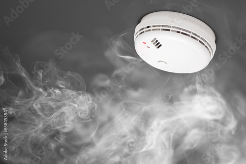 smoke detector of fire alarm in action Canvas Print